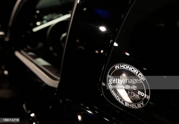 A picture of racecar driver Carroll Shelby is displayed on a Shelby American Inc Shelby 1000 at The Gallery in the MGM Grand Detroit ahead of the...