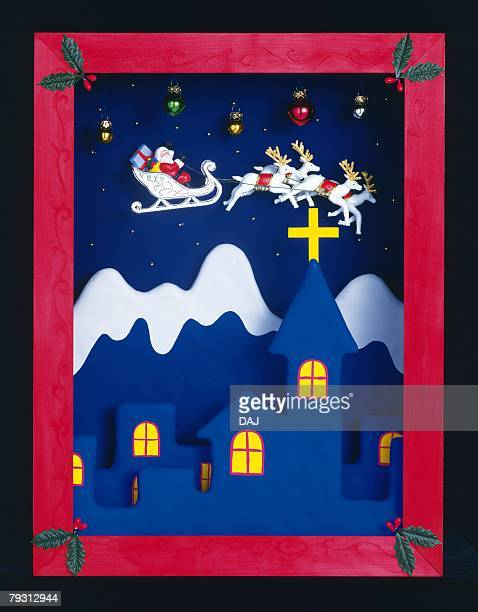 Picture of Santa Claus riding sled pulled by deers in the sky, front view