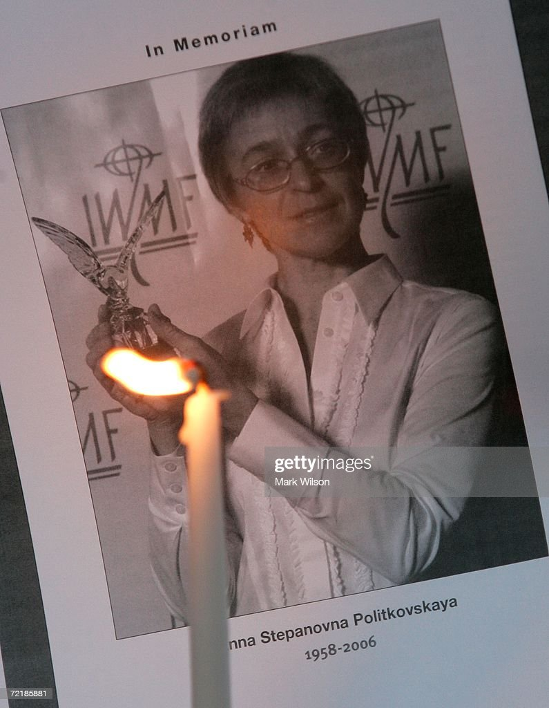 A picture of slain journalist Anna Politkovskaya is shown during a candlelight vigil in front of the Russian Embassy October 16, 2006 in Washington DC. Politkovskaya, who wrote impassioned stories about human rights abuses in war-torn Chechnya for Novaya Gazeta newspaper, was shot and killed in the elevator of her Moscow apartment building October 7. Many view her slaying as a political assassination. Russian President Vladimir Putin, whose government was frequently the target of Politkovskaya's investigative reporting, has condemned the murder.