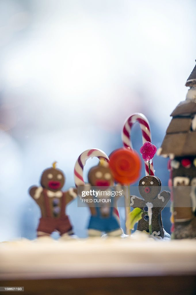 Picture of small characters on a Christmas cake taken on December 20, 2012 in Paris at the Sugarplum Cake Shop, an authentic American Coffee Shop. AFP PHOTO / FRED DUFOUR
