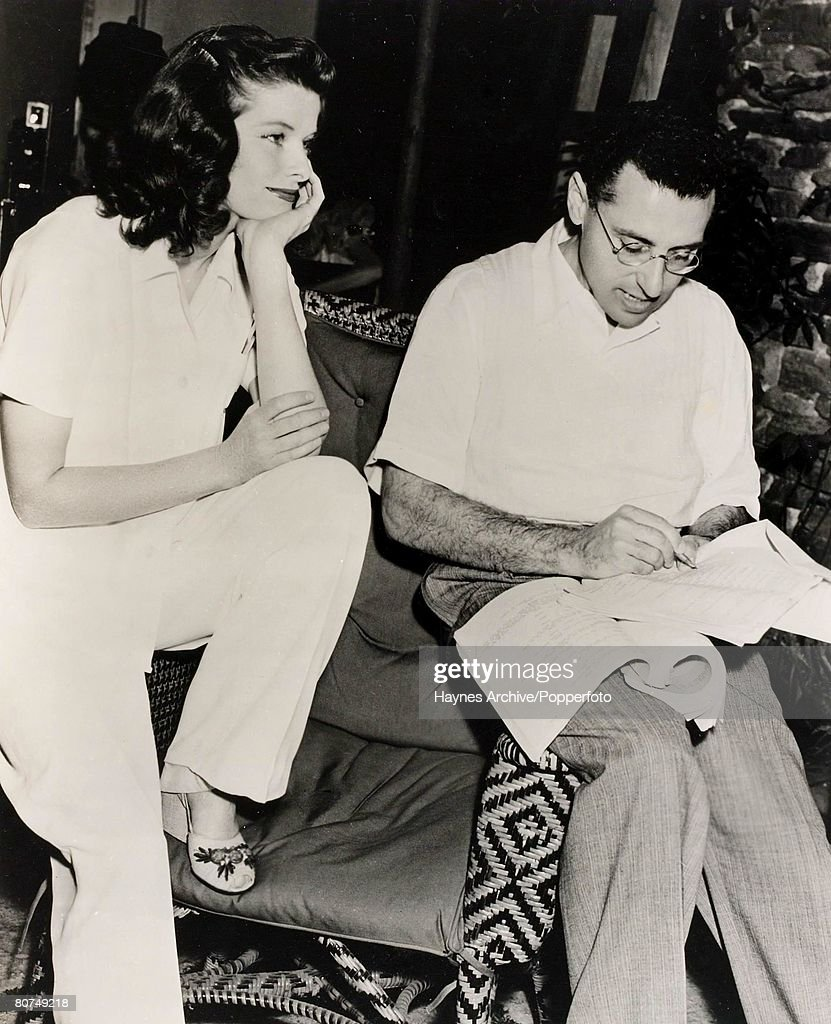 1940, A picture of the American Film actress Katherine Hepburn talking over the script of the film 'The Philadelphia Story,' in Hollywood with director <a gi-track='captionPersonalityLinkClicked' href=/galleries/search?phrase=George+Cukor&family=editorial&specificpeople=226979 ng-click='$event.stopPropagation()'>George Cukor</a>