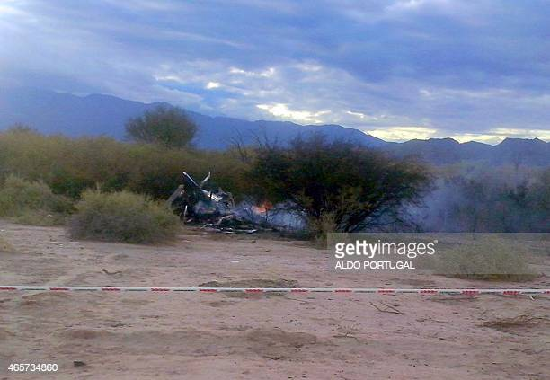 Picture of the burning wreckages of two helicopters which collided midair near Villa Castelli in the Argentine province of La Rioja on March 9 2015...