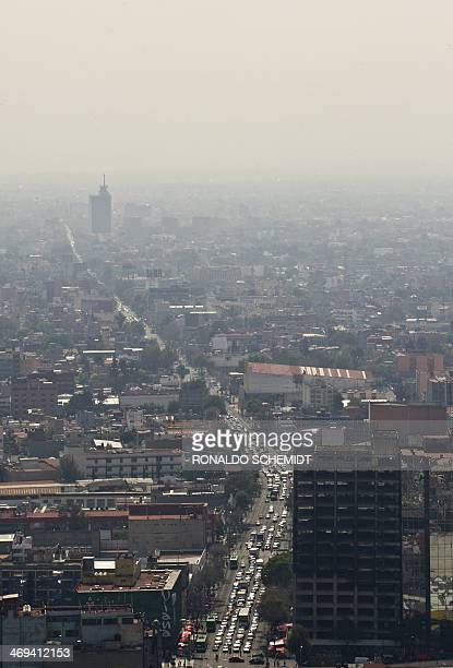 Picture of the concrete jungle of Mexico City seen through smog on February 14 2014 from the Latin American Tower AFP PHOTO/RONALDO SCHEMIDT