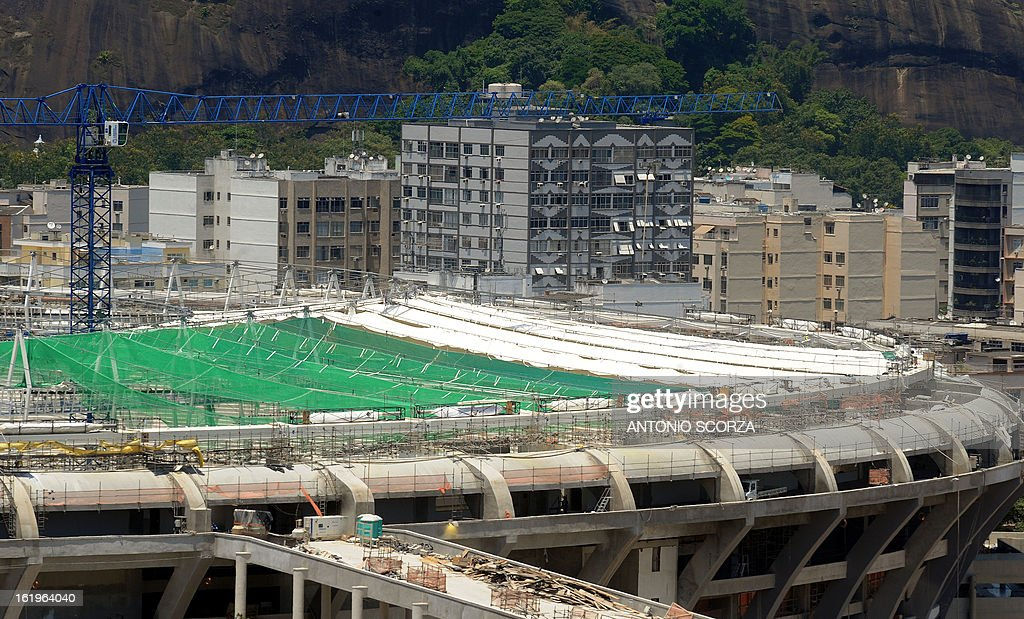Picture of the famed Maracana football stadium in Rio de Janeiro taken on February 18, 2013 as renovation works for the 2014 World Cup -- including the construction of a roof -- gets underway. The Maracana is classified as an historic monument so the facade will be maintained but a roof will be added to the five-storey oval stadium. AFP PHOTO/ANTONIO SCORZA