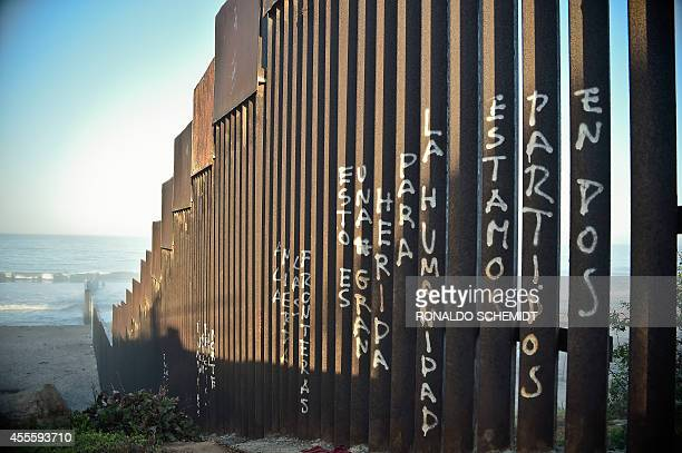 Picture of the fence that divides Mexico and the US in Tijuana Baja California State Mexico taken on September 17 2014 AFP PHOTO/RONALDO SCHEMIDT /...