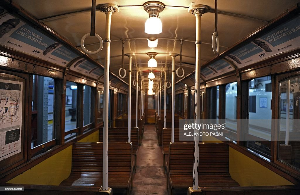 Picture of the interior of one of the historic wagons La Brugeoise of subway Line A, which is expected to be close soon following a decision by city mayor Mauricio Macri to replace the fleet with Chinese-made wagons, in Buenos Aires, on December 29, 2012. Line A was the first subway line to work in the southern hemisphere and its trains are among the ten oldest still working daily. The La Brugeoise wagons were constructed between 1912 and 1919 by La Brugeoise et Nicaise et Delcuve in Belgium.