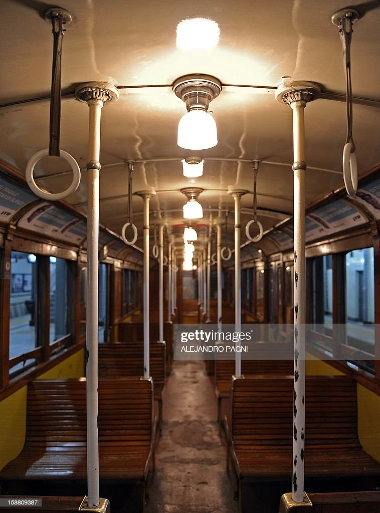 Picture of the interior of one of the historic wagons La Brugeoise of subway Line A, which is expected to be close soon following a decision by city mayor Mauricio Macri to replace the fleet with Chinese-made wagons, in Buenos Aires, on December 29, 2012. Line A was the first subway line to work in the southern hemisphere and its trains are among the ten oldest still working daily. The La Brugeoise wagons were constructed between 1912 and 1919 by La Brugeoise et Nicaise et Delcuve in Belgium. AFP PHOTO / ALEJANDRO PAGNI --- MORE PICTURES IN IMAGE FORUM