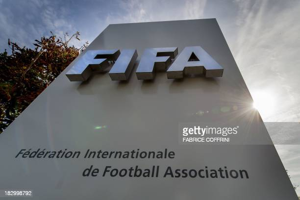 Picture of the logo of the Global football's governing body FIFA taken on October 3 2013 at its headquarters in Zurich Claims that migrant workers...