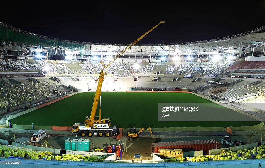 Picture of the Maracana football stadium in Rio de Janeiro, Brazil taken on March 27, 2013 as renovation works for the 2014 World Cup -- including the construction of a roof -- get underway. The Maracana, a historic monument, will keep its facade but a new roof will be added to the already five-storey oval stadium.