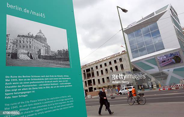 A picture of the remains of the Stadtschloss or City Palace at the end of World War II is seen in front of the construction site and 'HumboldtBox'...
