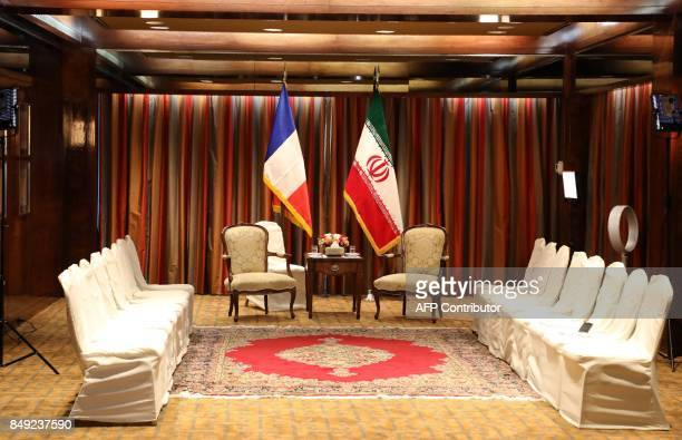 A picture of the seating area is taken before a meeting between French President Emmanuel Macron and his Iranian counterpart Hassan Rouhani at a...