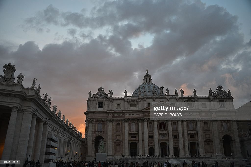 Picture of the St Peter's basilica taken at sunset on the eve of the conclave on March 11, 2013 at the Vatican. Catholic cardinals had a final day of jockeying for position the same day before shutting themselves into the Sistine Chapel to elect a new pope after Benedict XVI's shock resignation, with an Italian and a Brazilian who both head powerful archdioceses among the top contenders.