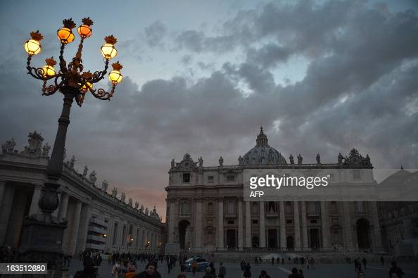 Picture of the St Peter's basilica taken at sunset on the eve of the conclave on March 11 2013 at the Vatican Catholic cardinals had a final day of...