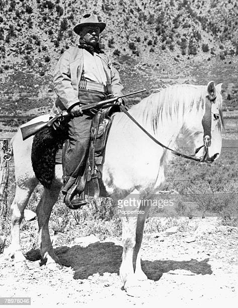 1908 A picture of Theodore Roosevelt President of the USA from 190109 riding a horse and holding a rifle on a hunting holiday in Colorado