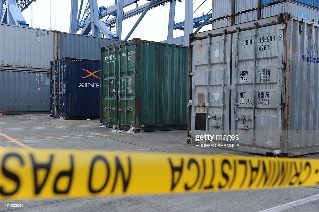 Picture of three containers of the North Korean Chong Chon Gang vessel in which an alleged ageing Soviet-built radar control system for surface-to-air missiles was found, taken at the Manzanillo Port in Colon, 90 km from Panama City, on July 19, 2013. UN sanctions experts will go to Panama soon to investigate a North Korean ship that was intercepted carrying weapons, a US diplomat said Thursday. The vessel set out from Cuba and was trying to enter the Panama Canal when it was stopped by an anti-narcotics patrol, which later found the weapons concealed beneath several tonnes of sugar. AFP PHOTO / Rodrigo ARANGUA