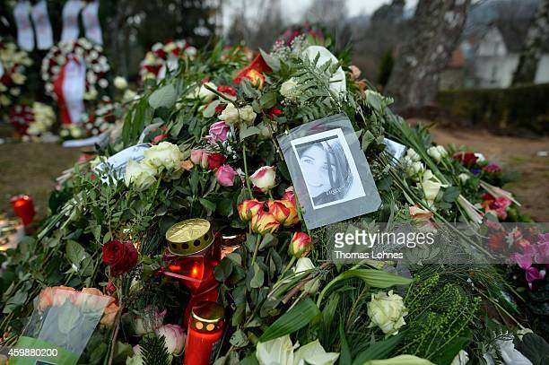 A picture of Tugce and flowers are placed at the grave of Tugce Albayrak the 23yearold university student who died after she was attacked in a...