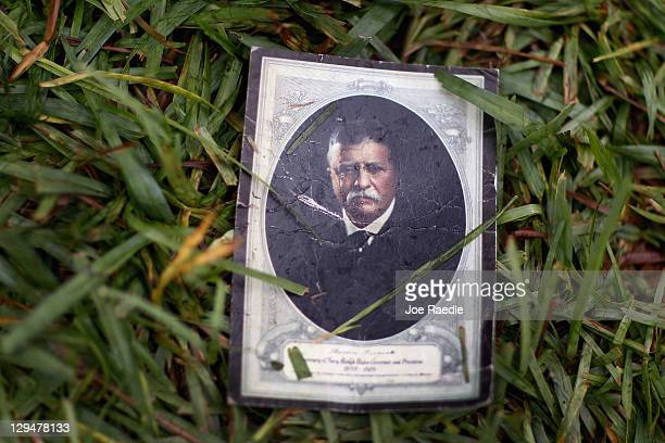 A picture of US President Theodore Roosevelt lays on the ground at a tent encampment that Occupy Miami protesters have placed in front of the...
