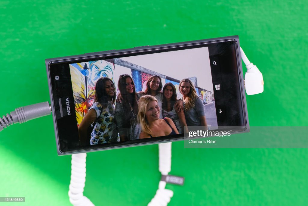 A picture of visitors seen on the Nokia Lumia 735 phone at the Nokia Lumia 735 Skype and Selfie Pod at the East Side Gallery on September 6 2014 in...
