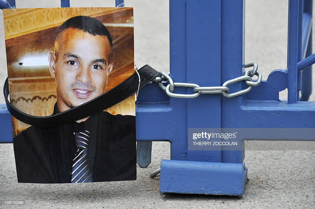A picture of Wissam El-Yamni, a young man who died following his arrest one year ago has been set at the entrance of Clermont-Ferrand's courthouse, on January 1, 2013, during a demonstration to call for 'the truth' regarding his the death. AFP PHOTO THIERRY ZOCCOLAN