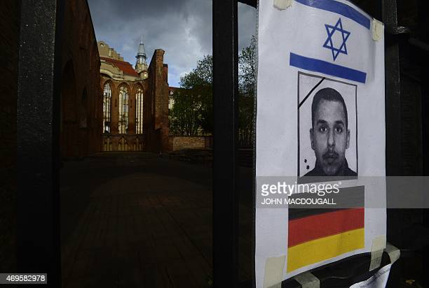 A picture of Yosi Damari a 22 yearold man from Israel who was found beaten to death hangs at a gate at the ruins of the downtown Gothic church...