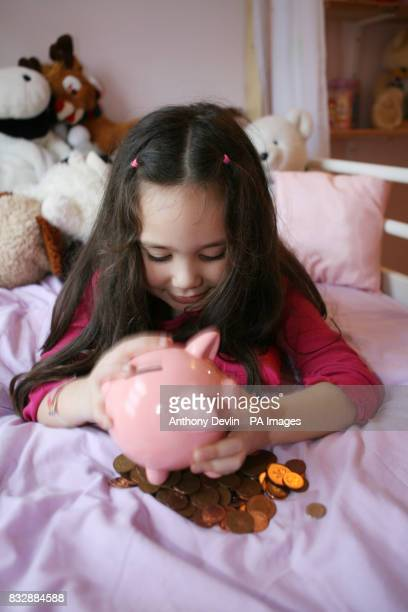 Picture posed by model Jazmin Camilleri four and her piggy bank Picture taken with parental permission