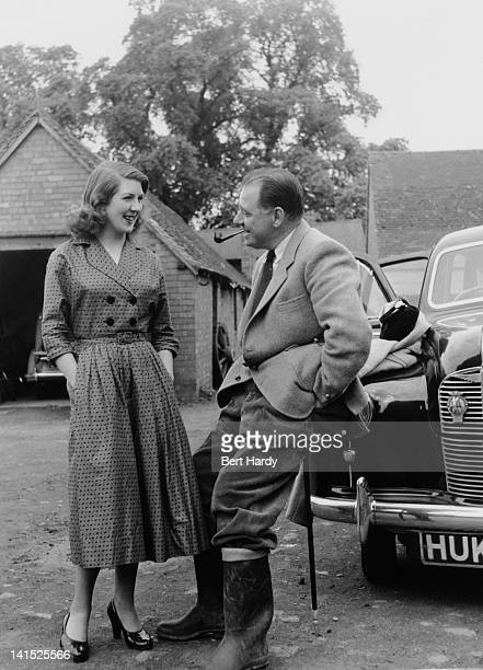 Picture Post photographer Bert Hardy with actress Pamela Mant who plays Christine Barford in the radio soap opera 'The Archers' June 1953 Original...