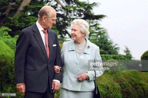 Picture released 18 November 2007 shows Britain's Queen Elizabeth II and her husband the Duke of Edinburgh walk at Broadlands Hampshire earlier in...