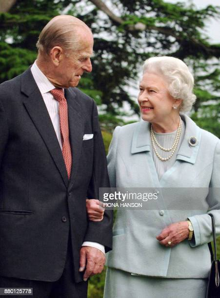 Picture released 18 November 2007 shows Britain's Queen Elizabeth II and her husband the Duke of Edinburgh walk at Broadlands in the Hampshire...