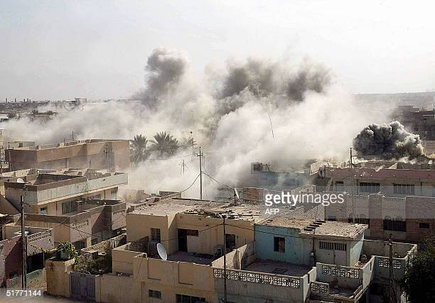 A picture released 21 November 2004 by the Multi National ForceIraq shows an insurgent stronghold going up in smoke after being struck by a precision...