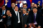 Spanish actor of the film 'The 33' Antonio Banderas poses in Santiago on August 02 2015 amidst the 33 miners who remained trapped in a mine at a...