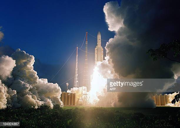 A picture released by CNES Arianespace shows the European launcher Ariane 5 blasting off on July 8 2008 at the Kourou base in French Guiana to place...