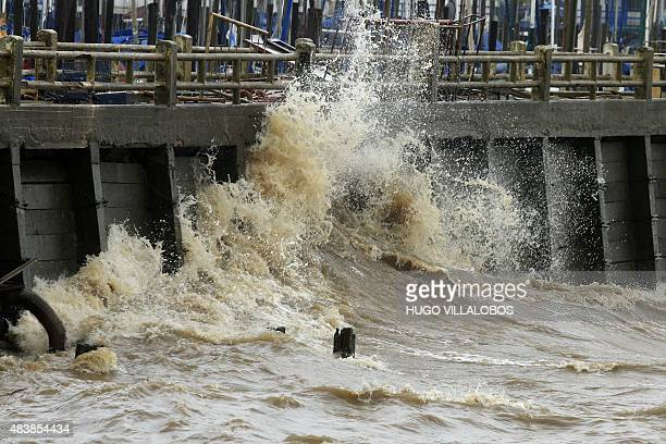 Picture released by Noticias Argentinas of a wave breaking into a quay in Buenos Aires Argentina on August 13 due to strong southeastern winds in the...