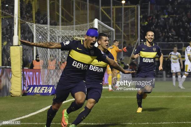 Picture released by Telam showing Boca Juniors' forward Ricardo Centurion celebrating next to teammates forward Cristian Pavon and forward Dario...