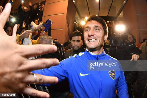 Picture released by Telam showing the coach of Boca Juniors Guillermo Barros Schelotto greeting fans after the result of another match gave them the...