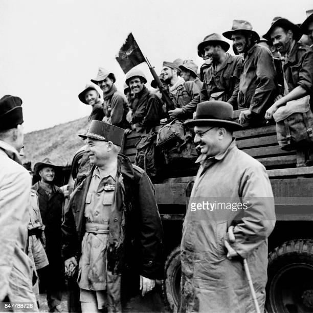 Picture released in 1950 of Jean Letourneau Minister of State for Relations with Associated States and Marshal Juin visiting French troops during the...