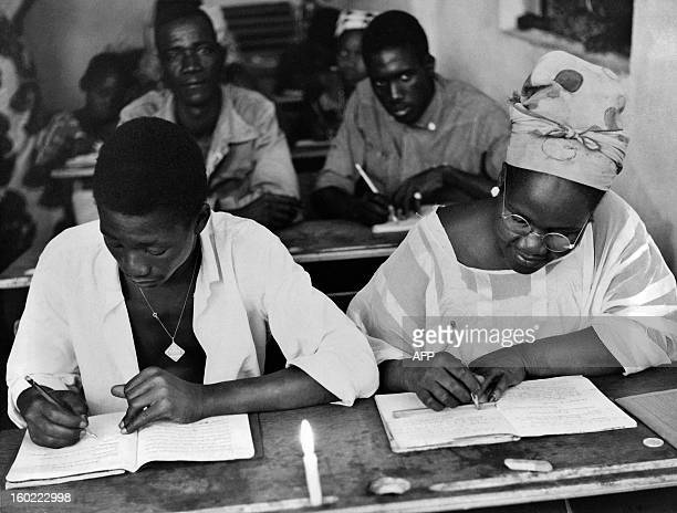 Picture released in 1964 in Ouolofobougou near Bamako of an adult literacy class as Unesco sent an expert in education to assist Government of Mali...