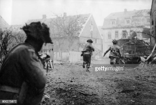 Picture released on April 12 1945 of British soldiers of the 2nd Armored Division launching an offensive through the village of Westphalia near...