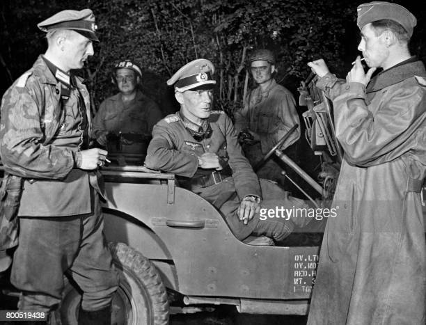 Picture released on August 20 1944 in Poche de FalaiseArgentan of Generalleutnant Otto Elfeldt smoking in a jeep with his German aides Friedrich Von...