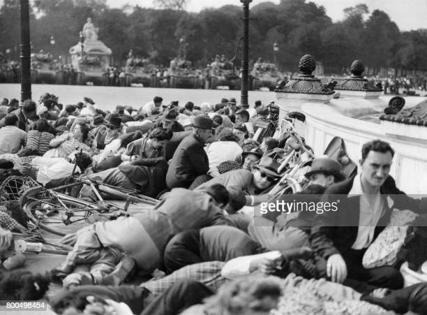 Picture released on August 26 1944 of Parisians taking cover from sporadic shooting during General Charles de Gaulle's parade on the Place de la...