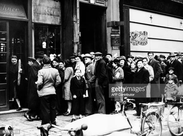 Picture released on December 31 1945 of Parisians queuing as the bread card and ration tickets carry on after the end of the second World War / AFP...