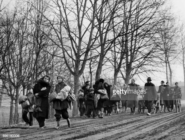 Picture released on February 19 1945 of German families leaving the fighting area near Calcar for safety behind the Allied lines as Canadian troops...
