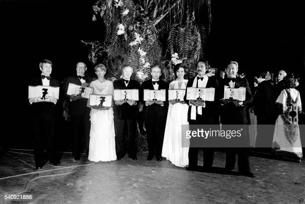 Picture released on June 7 1975 of Roger Gicquel Jacques Charon Nicole Courcel Jacques Chancel Stellio Lorenzi Denise Fabre Alain Delon and Charles...