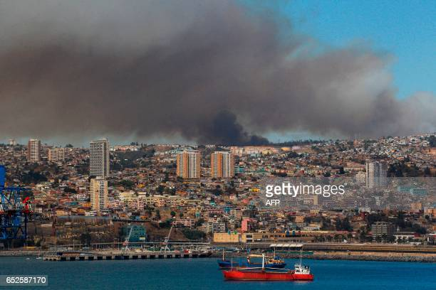 Picture released on March 12 2017 by Aton Chile shows smoke billowing from a forest fire in Valparaiso Chilean authorities decreed red alert in...