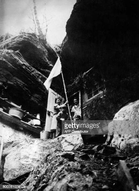Picture released on March 17 1945 of German civilians with white flag taking refuge in huts and hiding in hills to avoid bombings during the Second...