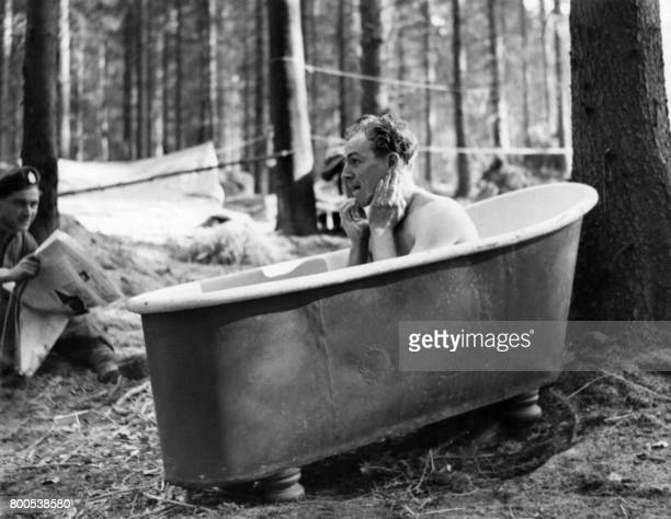 Picture released on March 24 1945 of Corporal JH McConville bathing in a bathtub from a wrecked German house in a forest of Germany at the end of the...