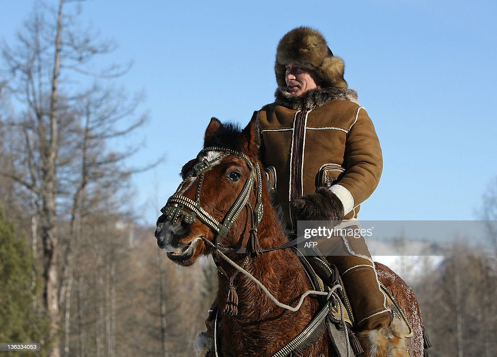A picture released on March 6 2010 shows Russian Prime Minister Vladimir Putin taking a horseback ride in the Karatash area near the town of Abakan...