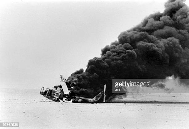 Picture released on November 17 1980 of a column of smoke billowing from an Iranian helicopter shot by Iraqi antiaircraft fire near Abadan during...