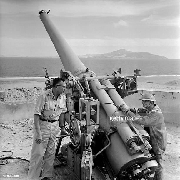 Picture released on November 30 1956 of Egyptian soldiers guarding the Tiran Island near a Canon 155 from Israeli attack in Egypt during the Suez...
