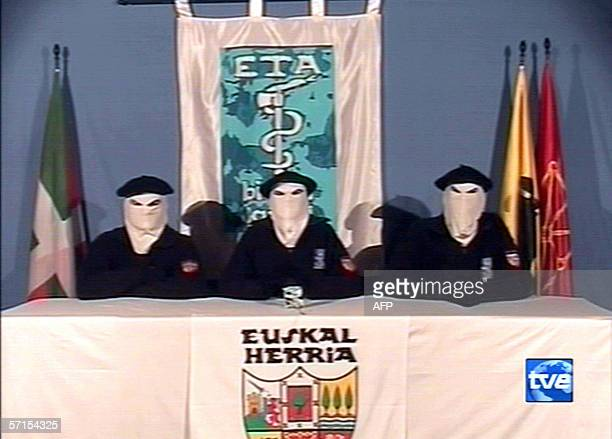 A picture released on Spanish tv channel TVE 22 March 2006 shows members of the Spains' Basque armed separatist organisation ETA announcing 22 March...