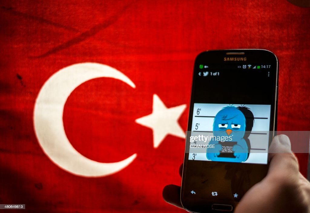 A picture representing a mugshot of the twitter bird is seen on a smart phone with a Turkish flag on March 26 2014 in Istanbul A Turkish court on...